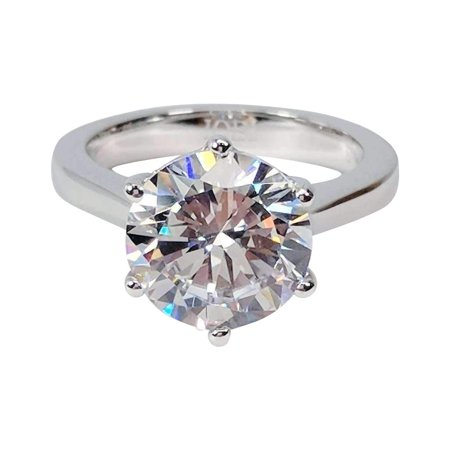 Platinum Diamond Solitaire (ON SALE - Victoria 4CT Round Cut IOBI Simulated Diamond Solitaire Ring 6 / Platinum Plated)