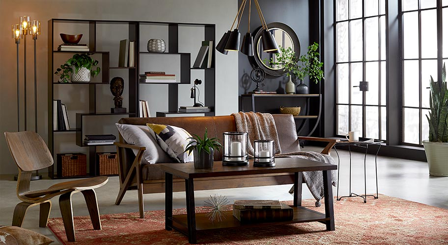 Industrial design endures because it's easy to mix, match and accessorize. Wood furniture, bold lighting and metal decor are softened with pillows, blankets and rugs.