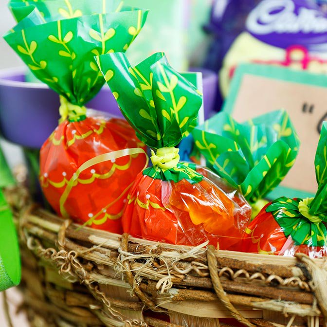 Orange candies in carrot shaped bags