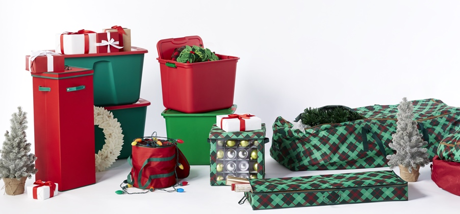 Red and green plastic storage bins for organizing holiday decorations alongside fabric storage containers that organize as well. Links to a blog post about how to reorganize your home after the holidays