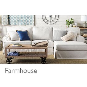 A farmhouse style living room with a rustic coffee table and galvanized metal wall accents. Links to where to shop for farmhouse style home design.