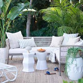 A modern coastal outdoor seating set with accent furniture. Links to where to shop coastal outdoor furniture and decor.