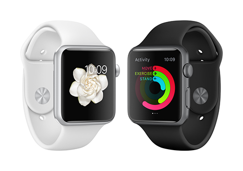 Black and white Apple Watches facing each other