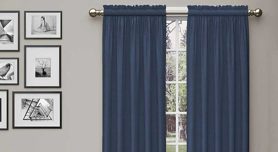 Block the light, keep the style with blackout curtains. They dramatically darken the room, insulate it and reduce noise in many stylish options.