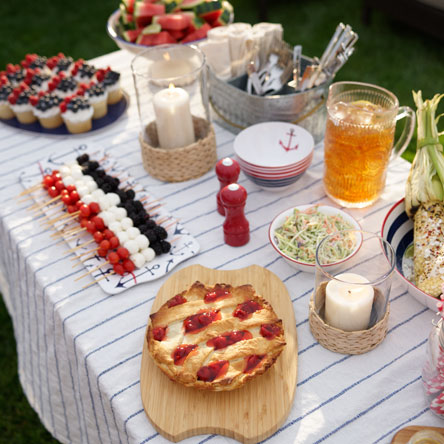 4th of July inspired desserts such as cherry pie, fruit kabobs and flag decorated cupcakes