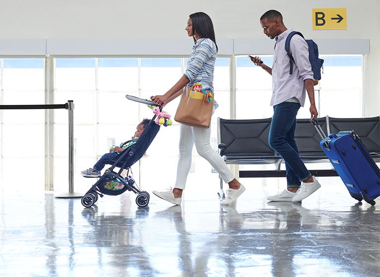 Bringing along baby. Folding strollers and more for a stress-free trip.